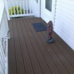 Trex Deck, Beautiful white vinly railing. Construction done by Bob Hall. Contact us for information.