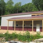 Kelly and Jay Young barn. Jensen Bridge Light gray steel, burgundy trim. Quality construction done by JBS construction.