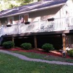 Yretto Antko Beautiful Deck. Consruction done by Don Maki. Trex clam shell, with white vinyl railings.